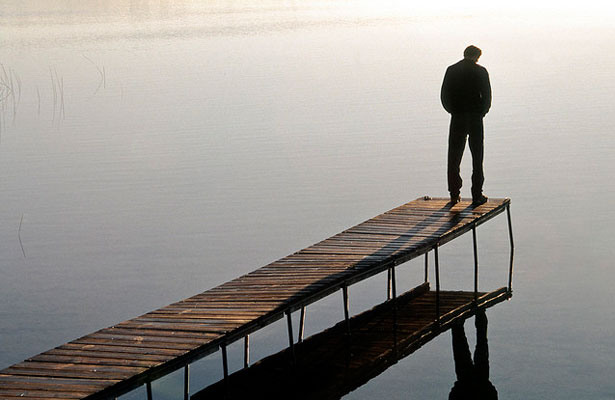 Man Pondering by a Lake
