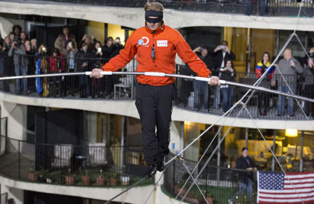 Nik Wallenda walking across the Chicago skyline blindfolded.